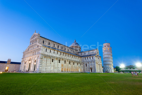 Piazza del Duomo with Pisa tower and the Cathedral illuminated a Stock photo © pixachi