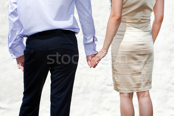Young married couple holding hands Stock photo © pixachi