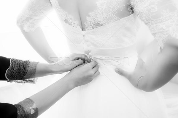 Bride getting dressed Stock photo © pixachi