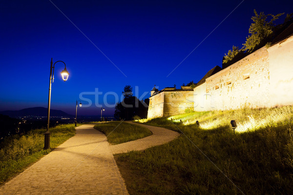 Alley arround old fortress 'Cetatuia' illuminated at night, Bras Stock photo © pixachi