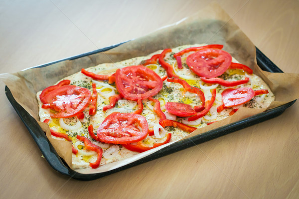 Delicious fresh traditional Italian focaccia bread with tomatoes, red peppers, onions, basil and oli Stock photo © pixachi