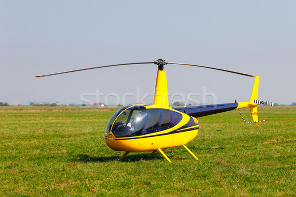 Yellow helicopter on field Stock photo © pixachi