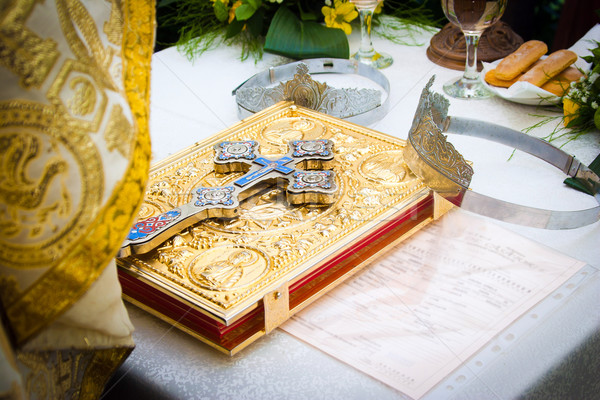 Wedding crowns and cross on a bible prepared for ceremony Stock photo © pixachi
