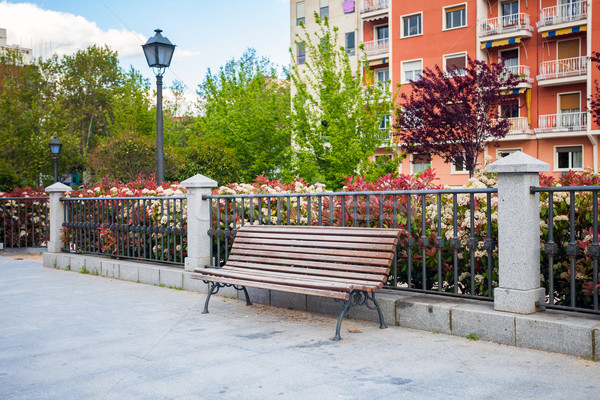 Bench in front of a typical residatial building in Madrid Stock photo © pixachi