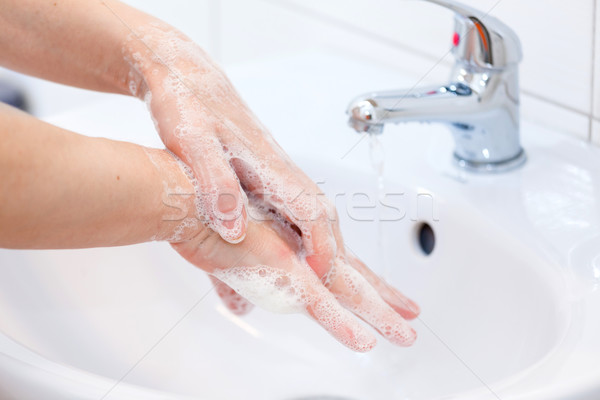 Washing of hands with soap under running water Stock photo © pixachi