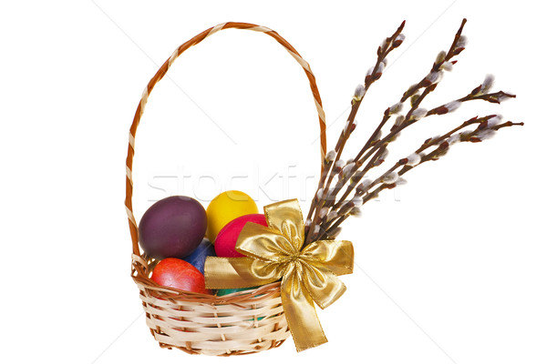 Stock photo: Easter palm catkins and basket with Easter eggs isolated on white background