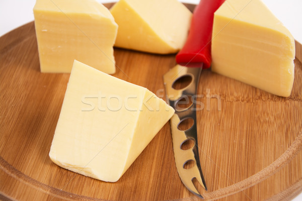Sliced cheese on the board in the kitchen Stock photo © pixelman