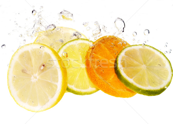 Agrios frutas Splash rebanada agua alimentos Foto stock © pixelman