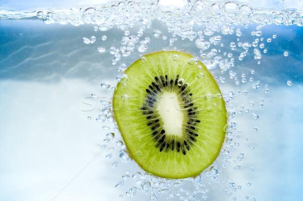 Kiwi rebanada azul agua aire burbuja Foto stock © pixelman