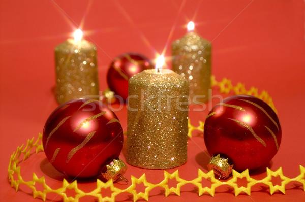 Ouro velas vermelho vidro ardente Foto stock © pixelman