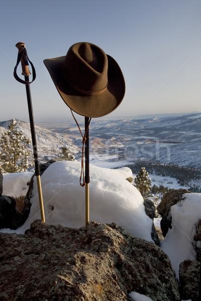 trekking poles and hat in mountain scenery Stock photo © PixelsAway