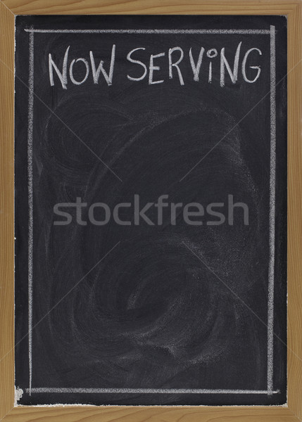 now serving on blackboard Stock photo © PixelsAway