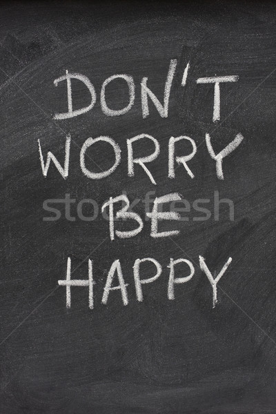 don't worry be happy phrase on blackboard Stock photo © PixelsAway