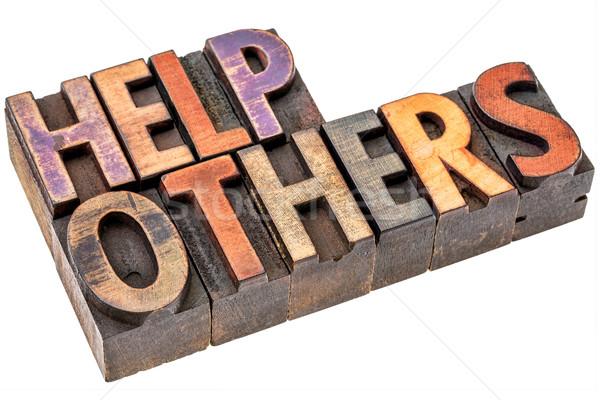 help others in wood type Stock photo © PixelsAway