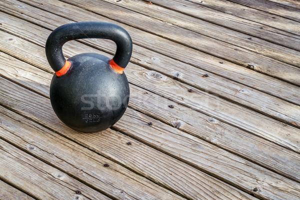 iron kettlebell on wood deck Stock photo © PixelsAway