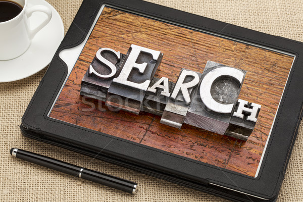 search word on digital tablet, Stock photo © PixelsAway