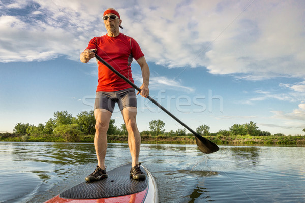 senior athletic paddler on paddleboard Stock photo © PixelsAway