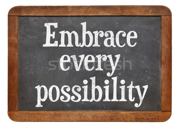 Embrace every possibility on blackboard Stock photo © PixelsAway
