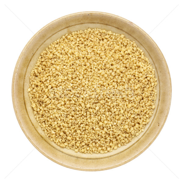 Volkoren couscous klein keramische kom geïsoleerd Stockfoto © PixelsAway
