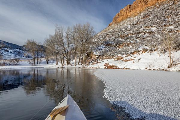 winter canoe paddling in Colorado Stock photo © PixelsAway