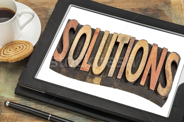 solutions word in on digital tablet Stock photo © PixelsAway