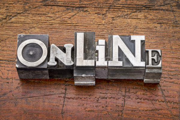 Stock photo: online word in metal type