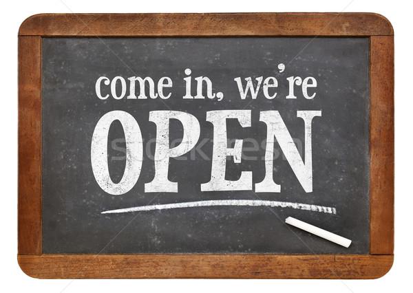 Come in, we are open blackboard sign Stock photo © PixelsAway