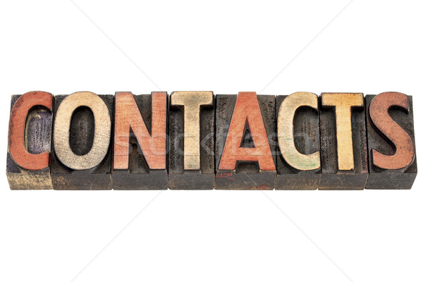 contacts word in wood type Stock photo © PixelsAway