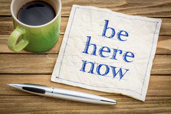Stock photo: Be here now napkin concept