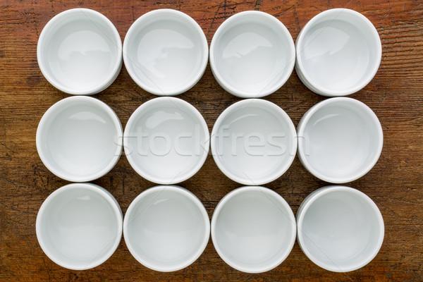 dozen of empty white tasting bowls Stock photo © PixelsAway