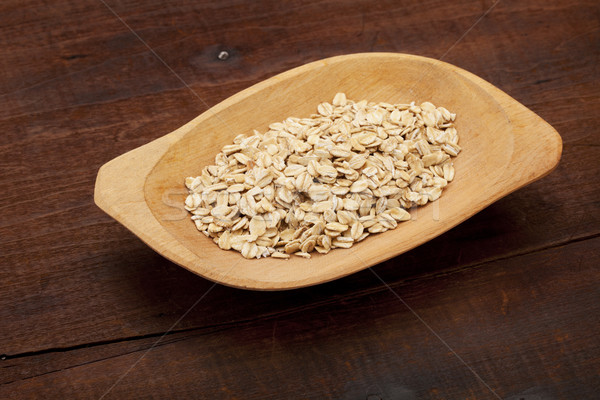 rolled oats in wooden bowl Stock photo © PixelsAway
