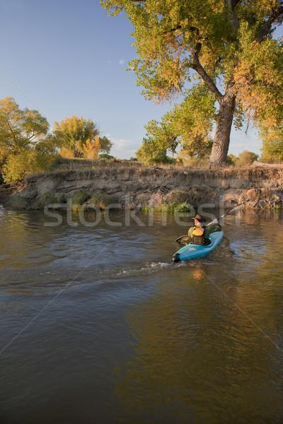 kayaker paddling across a river Stock photo © PixelsAway