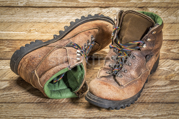 old heavy hiking boots agains wood Stock photo © PixelsAway