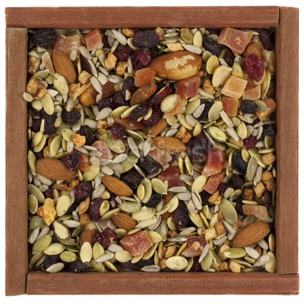 trail mix with nuts, berries and seeds in a wooden box Stock photo © PixelsAway