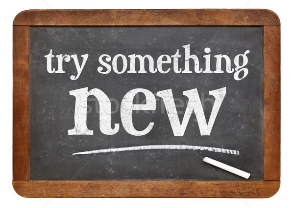 Try something new on blackboard Stock photo © PixelsAway