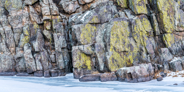 sandstone cliff and frozen river Stock photo © PixelsAway