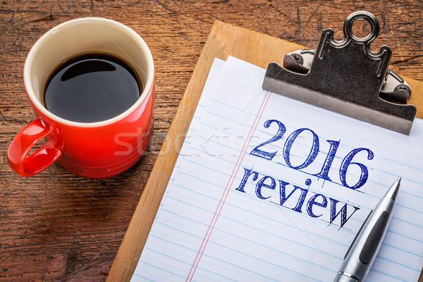 2016 review on blackboard on clipboard Stock photo © PixelsAway