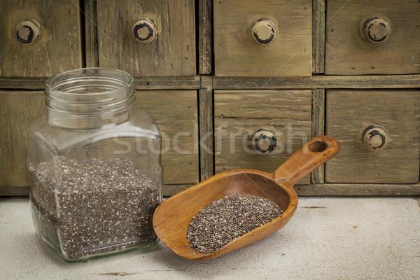 jar and scoop of chia seeds Stock photo © PixelsAway