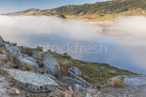mountain lake in a fog Stock photo © PixelsAway
