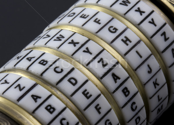Password or keyword - combination puzzle box with rings of letters Stock photo © PixelsAway