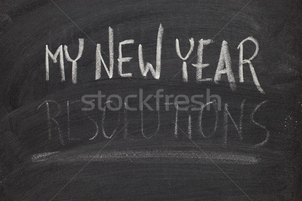 forgetting new year resolutions - concept on blackboard Stock photo © PixelsAway