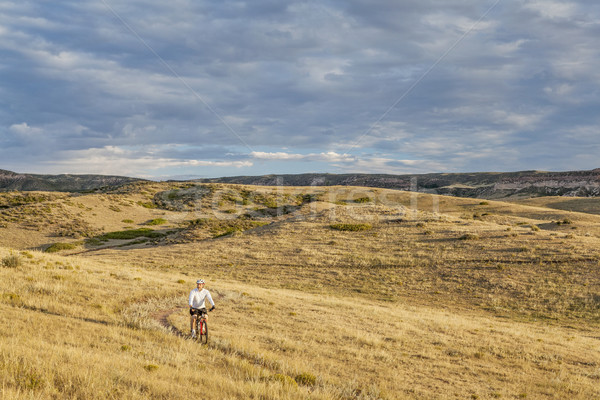 moutain biking in a rolling prairie Stock photo © PixelsAway