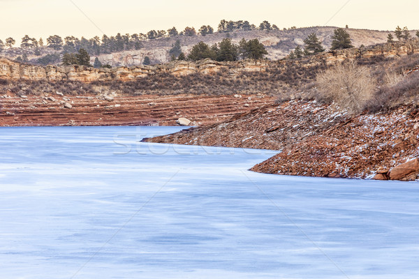 frozen lake with red cliffs Stock photo © PixelsAway