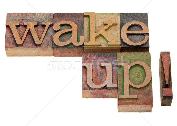 wake up - phrase in vintage letterpress type Stock photo © PixelsAway