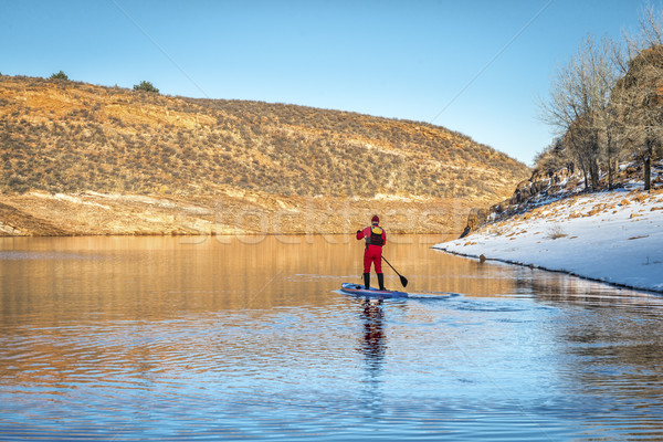 winter stand up paddling in Colorado Stock photo © PixelsAway