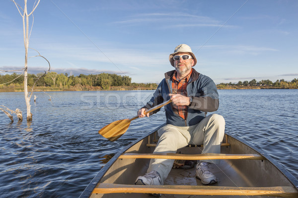 enjoying  morning canoe paddling Stock photo © PixelsAway