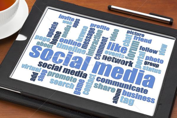 social media word cloud on tablet Stock photo © PixelsAway