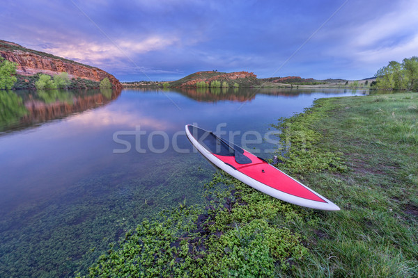 dusk over lake with paddleboard Stock photo © PixelsAway