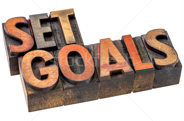 set goals abstract in wood type Stock photo © PixelsAway