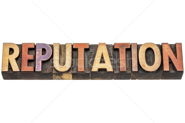 reputation word in wood type Stock photo © PixelsAway